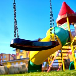 Swing on playground in a sunny day